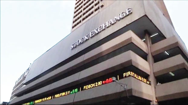 Stocks hit nine-month low on mixed earnings, elections